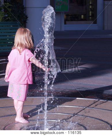 Girl Playing W Fountain