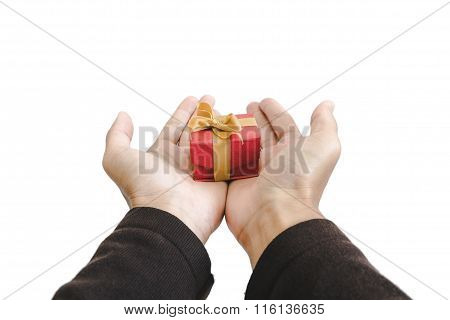 Hand holding, giving or receiving gift box, isolated on white background