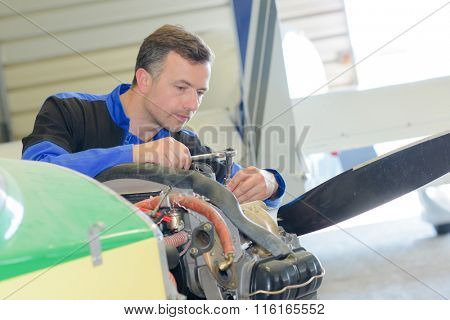 Man working on aircraft