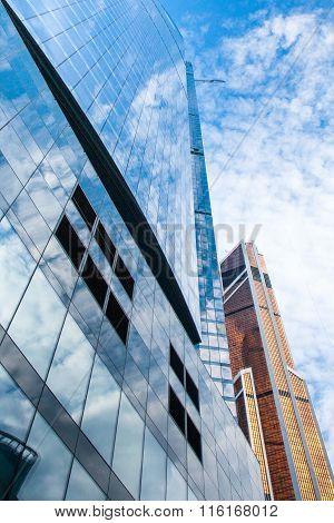 glass skyscraper and orane building