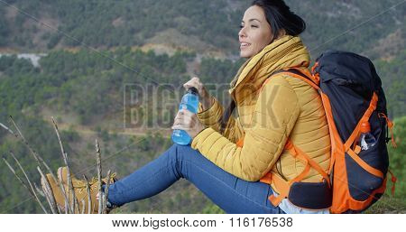 Young backpacker pausing for water