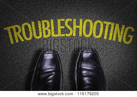 Top View of Business Shoes on the floor with the text: Troubleshooting