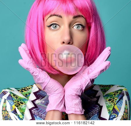 Fashion Portrait Of Cheerful Woman Inflating The Bubble Gumin Hot Pink Party Wig