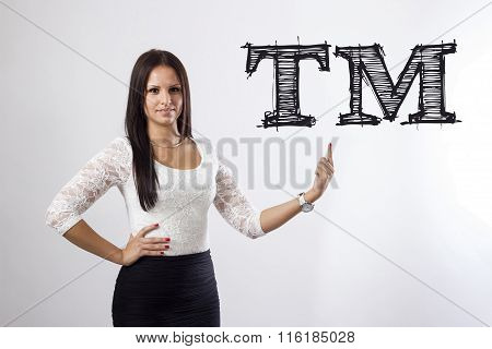 Tm Trade Mark - Beautiful Businesswoman Pointing