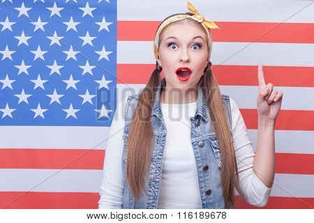 Cheerful young American woman has a great idea