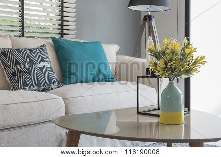 Modern Living Room With Modern Chair And Sofa With Vase Of Plants