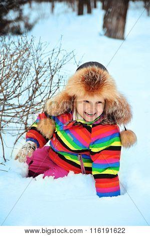 Cute little girl enjoys the snow