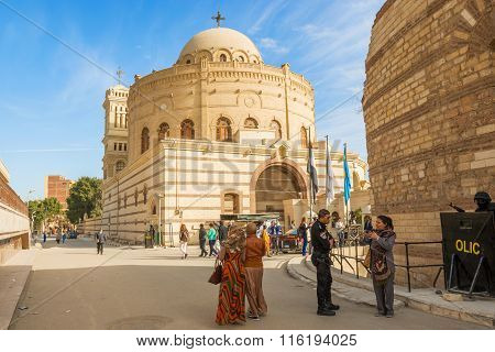Cairo, Egypt - January 3, 2015: Tourists visiting Hanging Coptic Church (El Muallaqa)in old Cairo Egypt.