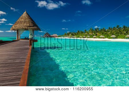 Luxurious wooden outdoor overwater spa on a tropical atol in Maldives