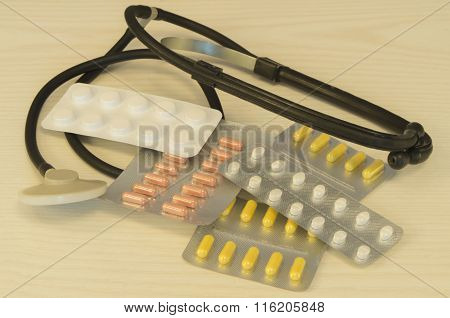 Phonendoscope And Pills Is On The Table