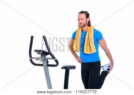 Young Man Warming Up For Train With Fitness Machine