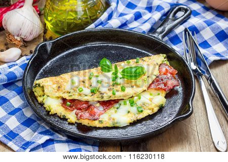 Bacon stuffed omelette on a iron cast pan poster