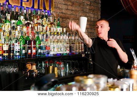 GRODNO BELARUS - NOV 7 2015: The bartender quickly working at a gastrobar HOUDINI in Grodno Belarus November, 7 2015