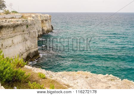 Rocky Cliffs At Torre Dell'orso Town In Salento, Italy