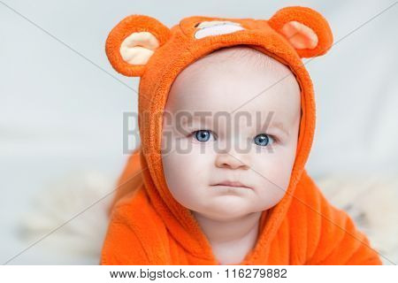 Portrait Of A Baby In A Suit Of Orange Tiger