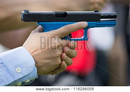 Hand Hold blue training Pistol And Slide poster