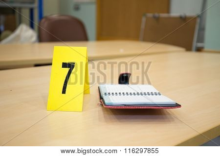 Yellow Evidence Number Pad And Evidence On Table