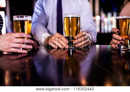 Friends having a beer in a bar