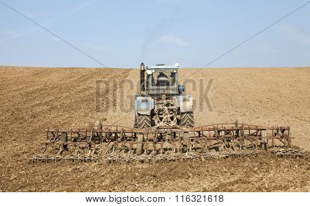 Harrowing The Soil With Tine Harrows