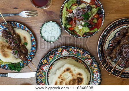 Souvlaki or kebab, meat skewer with pita bread and fresh vegetable