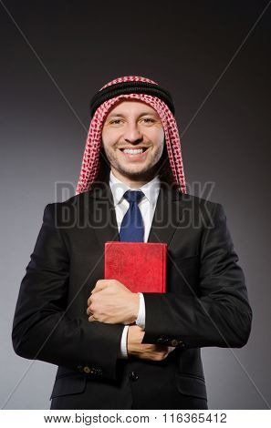 Arab man with book in diversity concept