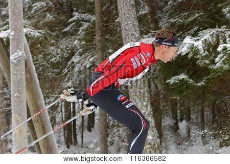 Side View Of Focused Cross Country Skiing Man In The Beautiful Forest