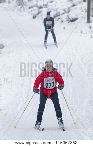 Cross Country Skiing Woman Followed By A Man