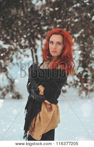 Young beautiful woman enjoys the snow