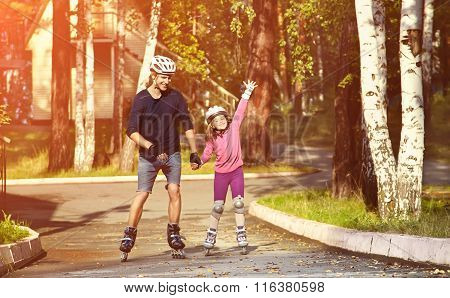 two people rollerblade