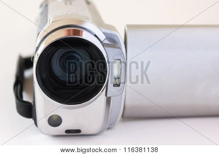 Focused On Lens Of Mini Video Recorder Put On White Background
