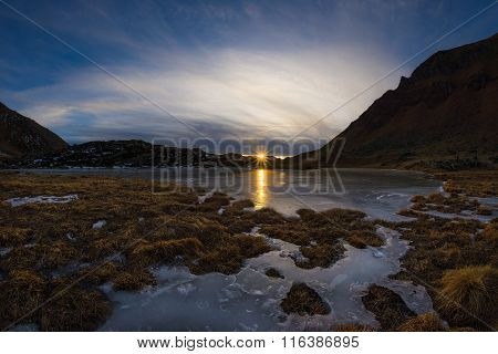 High Altitude Frozen Alpine Lake, Fisheye View At Sunset