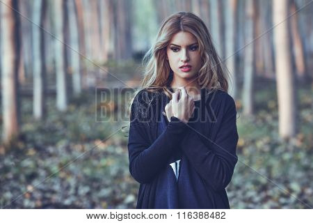 Thoughtful Woman Alone In A Poplar Forest