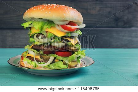 Big Cheeseburger Deluxe High On Green Wooden Background