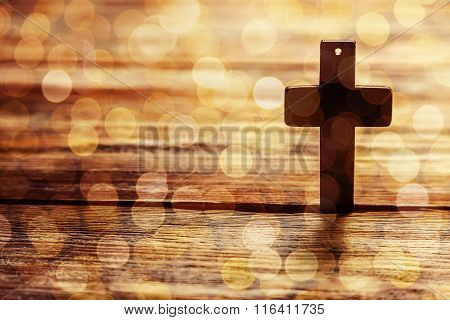 Old Cross On A Brown Wood