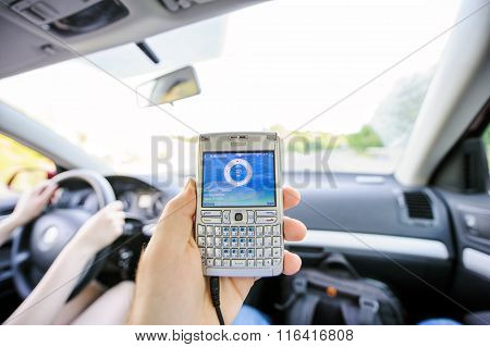 Man Cheking Speed And Direction On Gps Screen