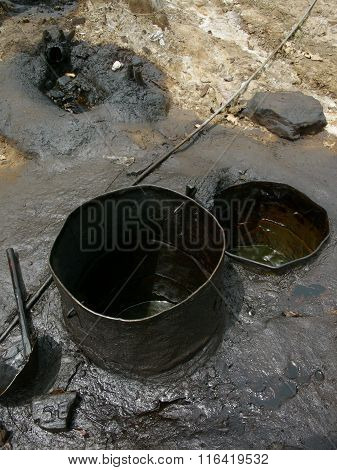Severe oil pollution pollutes earth and water at an illegal oil field in Java, Indonesia