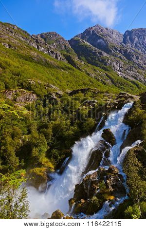 Waterfall near Briksdal glacier - Norway - nature and travel background