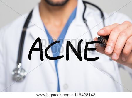 Doctor writing the word Acne