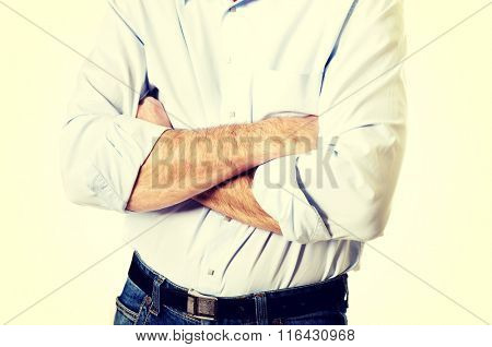 Close up of a man crossing his arms