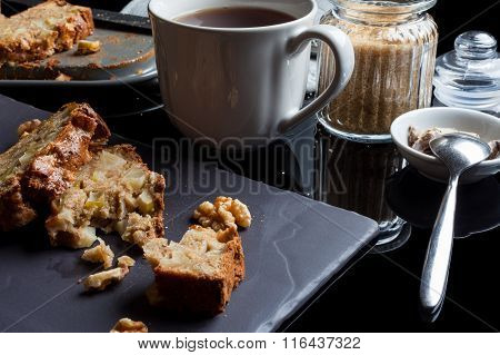 Pieces of apple cake and tea from side