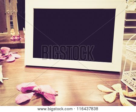 Blank Photo Frame On The Wood Table With Flower, digital Effect Vintage Style