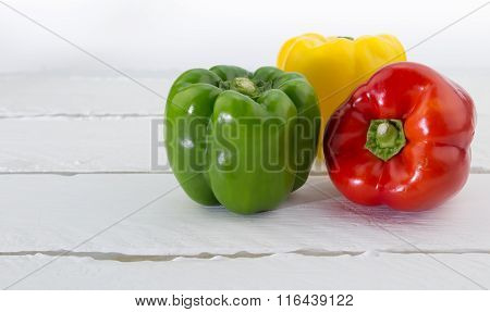 Green, Red And Yellow  Capsicum Isolated On White Background