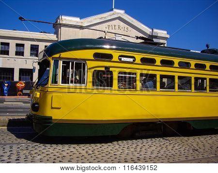 Yellow Tram At Pier 15 In San Francisco, California Usa