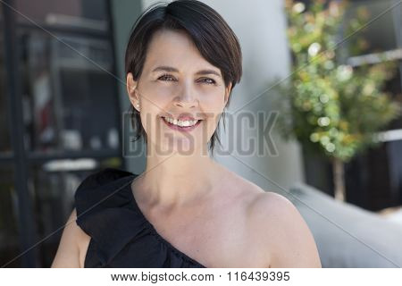 Happy latin adult woman smiling