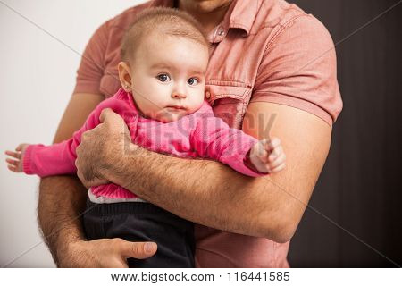 Baby Girl In The Arms Of Her Father