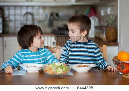 Two Sweet Children, Boy Brothers, Having For Lunch Spaghetti At Home