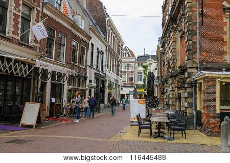 Tourists Walking On Lepelstraat Street In The Historic Center Of Haarlem. The Netherlands