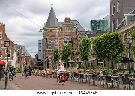 People Riding A Bike In The Historic Center Of Haarlem, The Netherlands