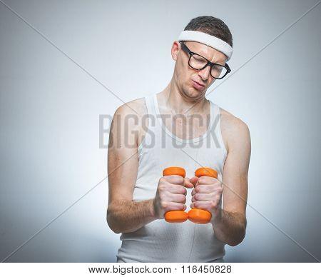 Tense Funny Man Holding Dumbbells