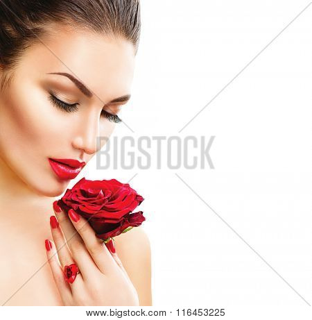 Beauty Woman with red rose isolated on white background. Fashion Model Girl face Portrait with Red Rose in her hand. Red Lips and Nails. Beautiful Luxury Makeup and Manicure Vogue Style